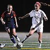 Garden City No. 14 Isabel Klatt, right, moves the ball downfield as South Side No. 11 Allison Mahoney pressures her during the Nassau County varsity girls' soccer Class B final Cold Spring Harbor High School on Tuesday, November 3, 2015. Klatt scored the game's only goal as Garden City won 1-0.<br /> <br /> James Escher