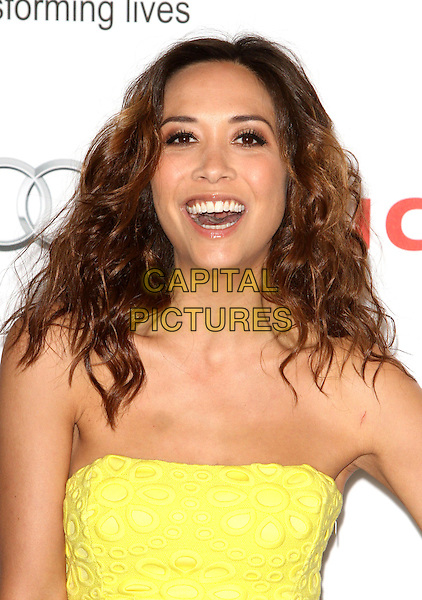 Myleene Klass<br /> Nordoff Robbins Silver Clef Awards at the Hilton, Park Lane, London, <br /> UK, June 28th 2013.<br /> portrait headshot strapless yellow smiling mouth open  <br /> CAP/ROS<br /> &copy;Steve Ross/Capital Pictures