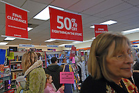 Customers sort though the last books to be sold at the Westerville, Ohio, B. Dalton bookstore on the final day of sales at the suburban store. The store, one of the smallest in the B. Dalton chain, was closing after nearly two decades tucked in the corner of a building housing an insurance company and a balloon store.(Gary Gardiner/EyePush Newsphotos)<br />