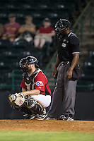 Hickory Crawdads catcher Chuck Moorman (29) on defense as home plate umpire Christopher Lloyd looks on during the game against the Charleston RiverDogs at L.P. Frans Stadium on August 25, 2015 in Hickory, North Carolina.  The Crawdads defeated the RiverDogs 7-4.  (Brian Westerholt/Four Seam Images)