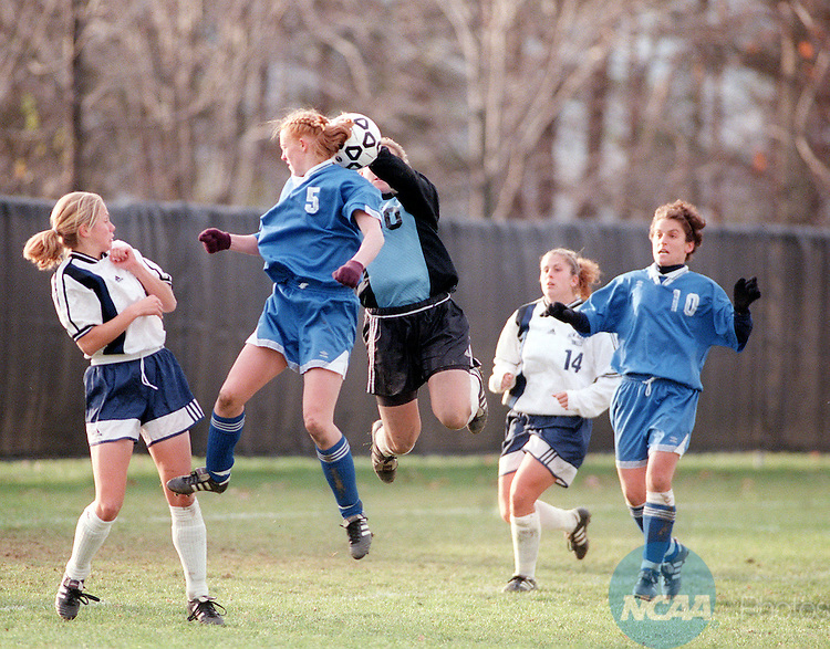 22 NOV 1998: College of New Jersey goalie Victoria Nusse (#00) reaches for the ball as Macalester College forward Holly Harris (#5) tries to head the ball toward the net during the Women's Division III Soccer Championship held at Ithaca College in Ithaca, NY. Macalester defeated New Jersey 1-0 in the second sudden death overtime period of the game. Nick Lisi/NCAA Photos