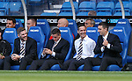 Ian Black sitting in the dugout pre-match with Kyle Hutton, Fraser Aird and Lee Wallace