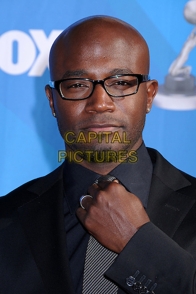 TAYE DIGGS.39th Annual NAACP Image Awards - Arrivals at the Shrine Auditorium, Los Angeles, California, USA..February 14th, 2008.headshot portrait glasses goatee facial hair hand.CAP/ADM/BP.©Byron Purvis/AdMedia/Capital Pictures