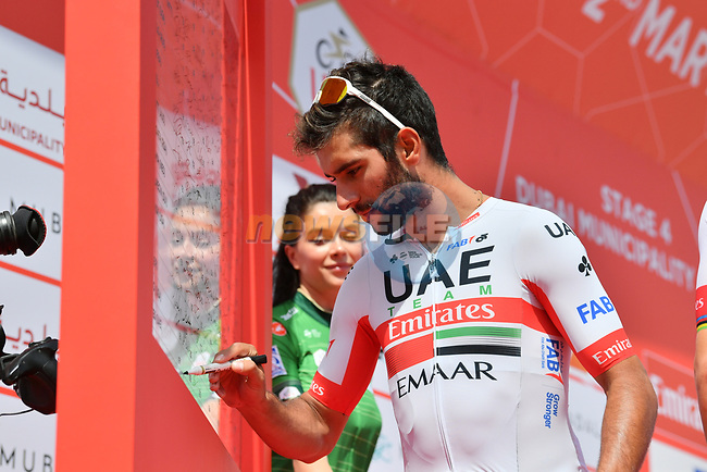 Fernando Gaviria (COL) UAE Team Emirates signs on before the start of Stage 4 of the 2019 UAE Tour, running 197km form The Pointe Palm Jumeirah to Hatta Dam, Dubai, United Arab Emirates. 26th February 2019.<br /> Picture: LaPresse/Massimo Paolone | Cyclefile<br /> <br /> <br /> All photos usage must carry mandatory copyright credit (© Cyclefile | LaPresse/Massimo Paolone)