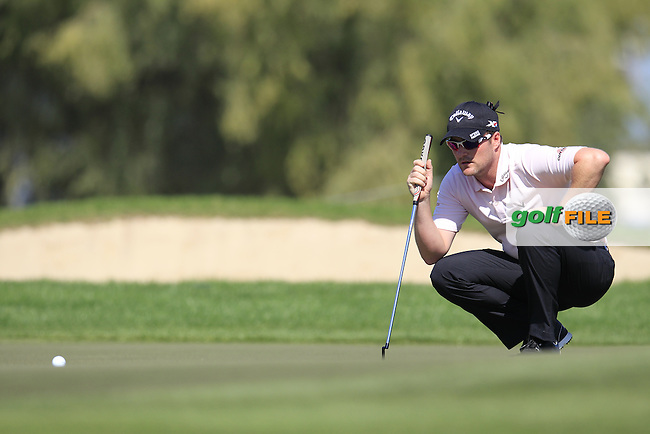 Marc WARREN (SCO) at the 1st green during Pink Friday's Round 2 of the 2015 Omega Dubai Desert Classic held at the Emirates Golf Club, Dubai, UAE.: Picture Eoin Clarke, www.golffile.ie: 1/30/2015