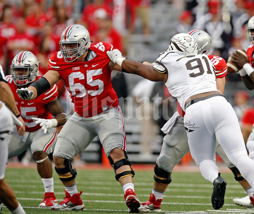 Ohio State Buckeyes offensive lineman Pat Elflein (65) against Western Michigan Broncos in their game at Ohio Stadium on September 26, 2015.  (Dispatch photo by Kyle Robertson)