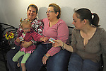 (L-r) Rebecca Bird, 41, with her future wife, Sandra Quandt, 48, and their witness, Rebecca's sister, Jamie Lee (far right), 28, and niece, Shelbie Stevens (in Rebecca's lap), 3, all from Davenport, Iowa, wait while Rebecca and Sandra wait for a marriage license at the Scott County Recorder's Office the first day same sex weddings are legal across Iowa in Davenport, Iowa on April 27, 2009.