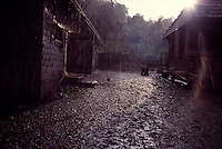 ROMANIA / Maramures / Valeni / July 2003..The courtyard of the Nemes family farm compound during a summer downpour...© Davin Ellicson / Anzenberger