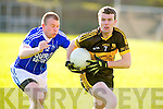 Dr Crokes Shane Doolan gets away from David McLoughlin, Kerins O'Rahillys during their club championship clash in Lewis Road, Killarney on Saturday evening.
