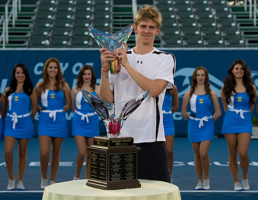 Kevin Anderson (RSA) poses with the trophy after his victory over Marinko Matosevic (AUS)  in their Final match today - Kevin Anderson (RSA) def Marinko Matosevic (AUS) 7-5 7-6(4)..ATP 250 Tennis - 2012 Delray Beach International Tennis Championships - Day 7 - Sunday 04 March 2012 - Delray Beach Stadium & Tennis Center - Delray Beach - Florida - USA..