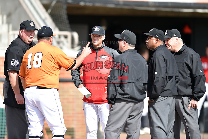 Tennessee Volunteers head coach Dave Serrano (18) talks with Georgia Bulldogs head coach Scott Stricklen (10) and umpires Jason Rogers, Fred Cannon, Donald Gillmore and Ray Miller before a game against the Georgia Bulldogs at Lindsey Nelson Stadium March 21, 2015 in Knoxville, Tennessee. The Bulldogs defeated the Volunteers 12-7. (Tony Farlow/Four Seam Images)