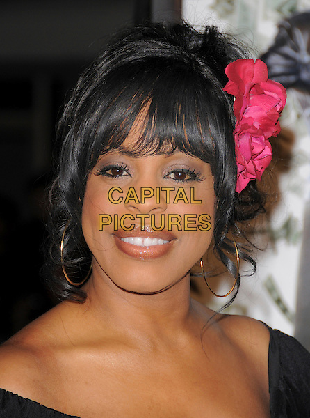 """NIECY NASH .Overature Pictures' L.A. Premiere of """"Mad Money"""" held at The Mann Village Theatre in Westwood, California, USA..January 9th, 2008.headshot portrait flower in hair pink gold hoop earrings                    .CAP/DVS.©Debbie VanStory/Capital Pictures"""