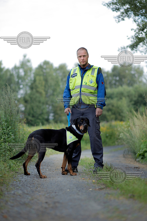 Arve Holm with his dog Sverdrup.<br /> <br /> Rescue workers interviewed following the terror attacks in Norway. ..A large vehicle bomb was detonated near the offices of Norwegian Prime Minister Jens Stoltenberg on 22 July 2011. .Another terrorist attack took place shortly afterwards, where a man killed 68 people, mainly children and youths attending a political camp at Ut&oslash;ya island. ..Anders Behring Breivik was arrested on the island and has admitted to carrying out both attacks..(photo:Fredrik Naumann/Felix Features)