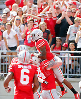 Ohio State Buckeyes wide receiver Philly Brown (10) celebrates his touchdown with Ohio State Buckeyes offensive linesman Jack Mewhort (74) during the 1st quarter of their college football game at Ohio Stadium in Columbus on September 7, 2013.  (Dispatch photo by Kyle Robertson)