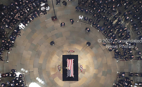 Cindy McCain, wife of the late U.S. Sen. John McCain, R-Ariz., stands over his casket as he lies in state in the U.S. Capitol Rotunda Friday, Aug. 31, 2018, in Washington. (Pool photo by Morry Gash via AP)