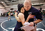 Lauren Clark-Johnson, a senior at Southeast Raleigh High School, hugs her wrestling coach Jeff Smith after defeating Matt Cox of West Carteret High School in a 112-lb division match at The Mark Adams Holiday Classic at Cary High School on Monday, Dec. 22, 2008.  Staff photo by Ted Richardson/The News & Observer