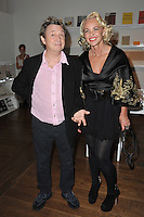 "Amanda Eliasch & Andy Summers of The Police at reception for Amanda Eliasch's neon art exhibition ""Peccadilloes"" at the Leadapron Gallery, West Hollywood..June 16, 2011  Los Angeles, CA.Picture: Paul Smith / Featureflash"