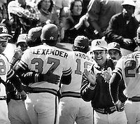 Oakland Athletics Gary Alexander is mobbed at home after hitting game winning Home Run.Wayne Gross and manger Bobby Winkless (center)(1978 photo by Ron Riesterer.