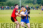 Dean Cassidy Kenmare Shamrocks in Action against Dara Sugrue Kenmare DIstrict in the Kerry Senior Football Championship in Templenoe on Friday Night