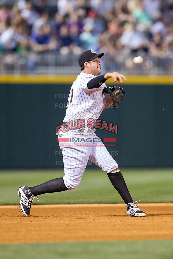 Charlotte Knights third baseman Alex Liddi (10) makes a throw to first base against the Lehigh Valley IronPigs at BB&T Ballpark on May 8, 2014 in Charlotte, North Carolina.  The IronPigs defeated the Knights 8-6.  (Brian Westerholt/Four Seam Images)