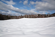 Snow covered sandpit along the Kancamagus Highway during the winter months in the White Mountains, New Hampshire USA. This area was part of the Swift River Railroad, which was an logging railroad in operation from 1906-1916.