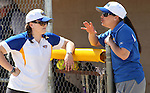 Western Nevada College Wildcats head softball coach Leah Wentworth, right, talks with Andrea Lazarri during Friday's game against Salt Lake Community College on April 1, 2011 in Carson City, Nev.  .Photo by Cathleen Allison