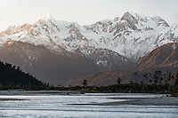 Sunrise over Southern Alps, Mount Tasman and Aoraki Mount Cook with reflections in Cook River in foreground, Westland Tai Poutini National Park, UNESCO World Heritage Area, West Coast, New Zealand, NZ