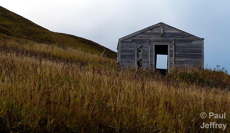 High on a hill above Unalaska, Alaska, an abandoned old house.