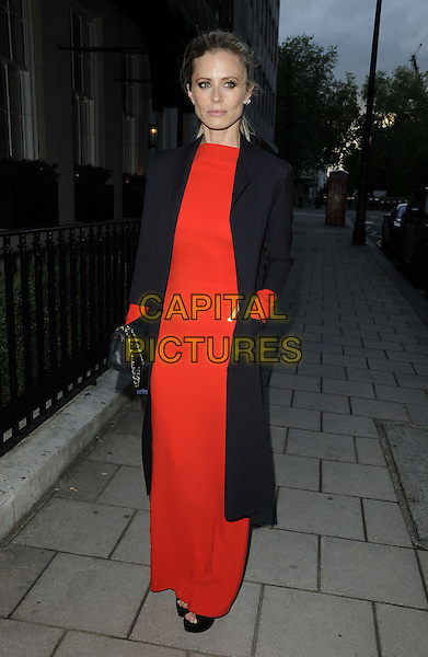 Laura Bailey.The Tom Ford dinner as part of the British Fashion Council's inaugural menswear showcase the London Collections for Men, 34 Bar & Restaurant, South Audley Street, London, England..15th June 2012.full length red dress black coat .CAP/CAN.©Can Nguyen/Capital Pictures.
