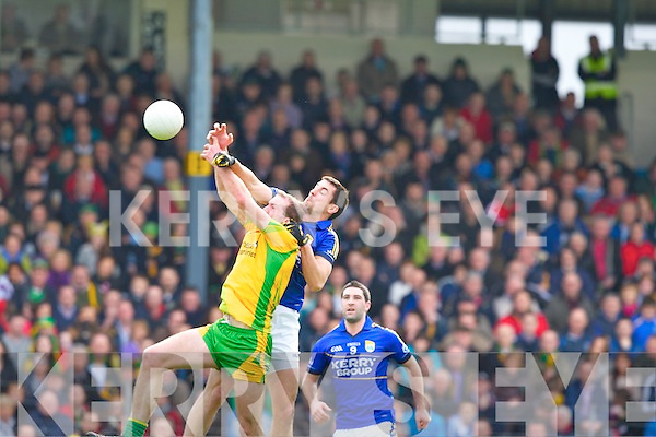 Anthony Maher and  Donegal's Neil Gallagher in this aerial battle during their Allainz league clash in Fitzgerald Stadium on Sunday