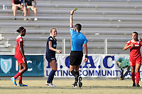 Cary, North Carolina  - Saturday August 19, 2017: Abby Dahlkemper is shown the yellow card by referee Elvis Osmanovic during a regular season National Women's Soccer League (NWSL) match between the North Carolina Courage and the Washington Spirit at Sahlen's Stadium at WakeMed Soccer Park. North Carolina won the game 2-0.