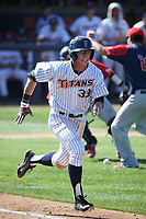 Hunter Cullen (33) of the Cal State Fullerton Titans runs to first base during a game against the Gonzaga Bulldogs at Goodwin Field on March 12, 2017 in Fullerton, California. Fullerton defeated Gonzaga, 3-2. (Larry Goren/Four Seam Images)