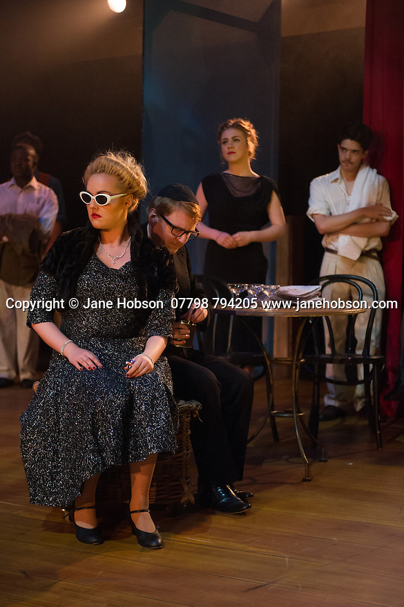 London, UK. 09.10.2014. Mountview Academy of Theatre Arts presents CURTAINS, at the Bernie Grant Arts Centre. Picture shows: Chloe Carroll (CARMEN BERNSTEIN) and Liam Farrow (OSCAR SHAPIRO). Photograph © Jane Hobson.