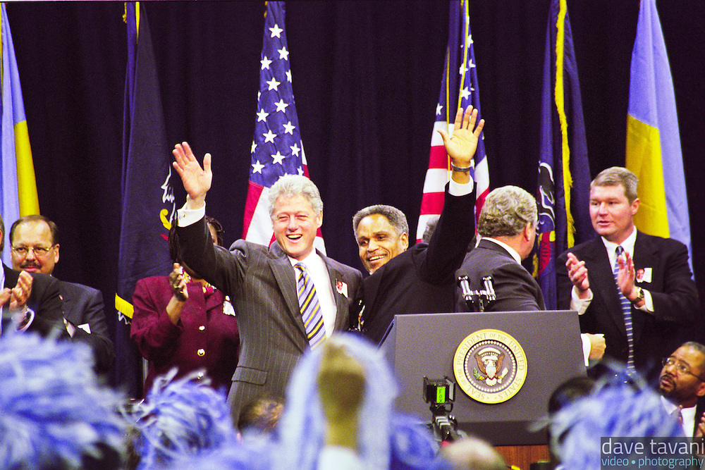 President Bill Clinton and Philadelphia mayoral candidate, John Street, wave to an enthusiastic crowd at the Tom Gola Arena at La Salle University on October 29, 1999.