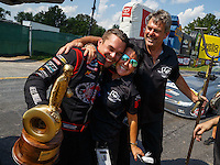 Sep 5, 2016; Clermont, IN, USA; NHRA top alcohol funny car driver Jonnie Lindberg celebrates with crew after winning the US Nationals at Lucas Oil Raceway. Mandatory Credit: Mark J. Rebilas-USA TODAY Sports