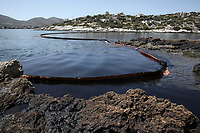 Pictured: A floating barrier used to contain the oil spill that has reached the coast of Salamina, Greece<br />