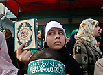 """Palestinian girl supporters of Hamas movement carry holy Quran shout anti-US President George W. Bush slogans during a protest against Bush's visit to Israel and Palestinian territories, 09 January 2008, in Gaza City. Bush landed in Israel today on the first visit of his presidency aimed at bolstering recently-revived peace talks.""""photo by Fady Adwan"""""""