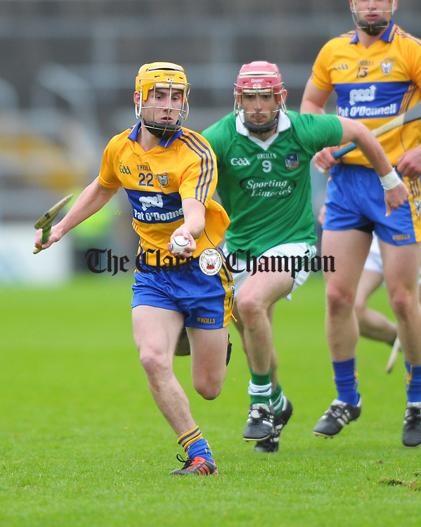 Colm Galvin of Clare in action against Paudie O Brien of Limerick during their game at Semple Stadium. Photograph by John Kelly.