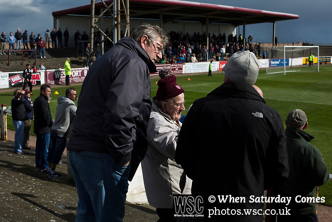 Arbroath 0 Edinburgh City 1, 15/03/2017. Gayfield Park, SPFL League 2. Home supporters chatting during a break in play during the first-half at Gayfield Park as Arbroath hosted Edinburgh City (in yellow) in an SPFL League 2 fixture. The newly-promoted side from the Capital were looking to secure their place in SPFL League 2 after promotion from the Lowland League the previous season. They won the match 1-0 with an injury time goal watched by 775 spectators to keep them 4 points clear of bottom spot with three further games to play. Photo by Colin McPherson.