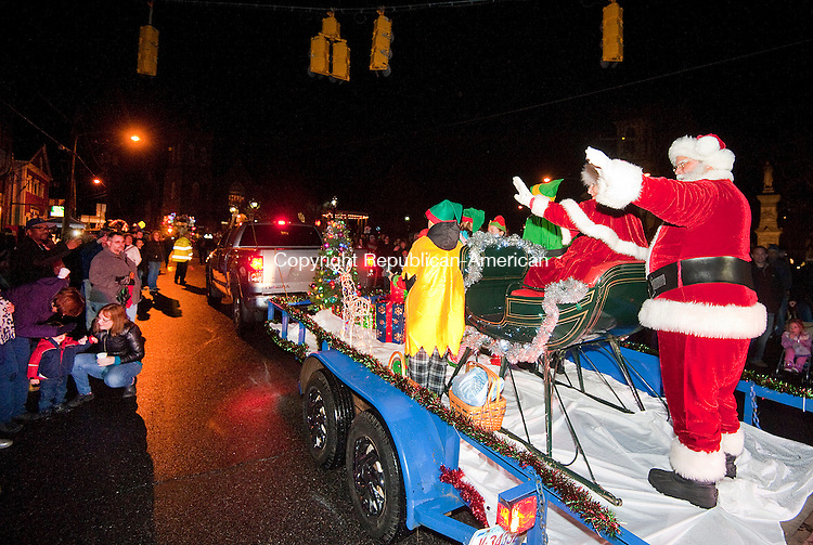 THOMASTON, CT--- -112815JS05--Santa and Mrs. Claus wave to the hundreds who lined Main Street during the annual Light Up Thomaston parade Saturday in downtown Thomaston. <br /> Jim Shannon Republican-American