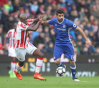 Chelsea's Diego Costa battles with Stoke City's Bruno Martins Indi<br /> <br /> Photographer Mick Walker/CameraSport<br /> <br /> The Premier League - Stoke City v Chelsea - Saturday 18th March 2017 - bet365 Stadium - Stoke<br /> <br /> World Copyright &copy; 2017 CameraSport. All rights reserved. 43 Linden Ave. Countesthorpe. Leicester. England. LE8 5PG - Tel: +44 (0) 116 277 4147 - admin@camerasport.com - www.camerasport.com