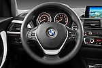 Steering wheel view of a 2011 - 2014 BMW 118d 5 Door hatchback.