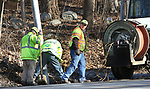 WOODBURY CT. 10 December 2018-121018SV03-DOT crews repair a drainpipe on Sherman Hill Road, Route 64, near Heritage Road in Woodbury Monday. This area is notorious in town for water flowing over it and freezing, often causing spinouts.<br /> Steven Valenti Republican-American