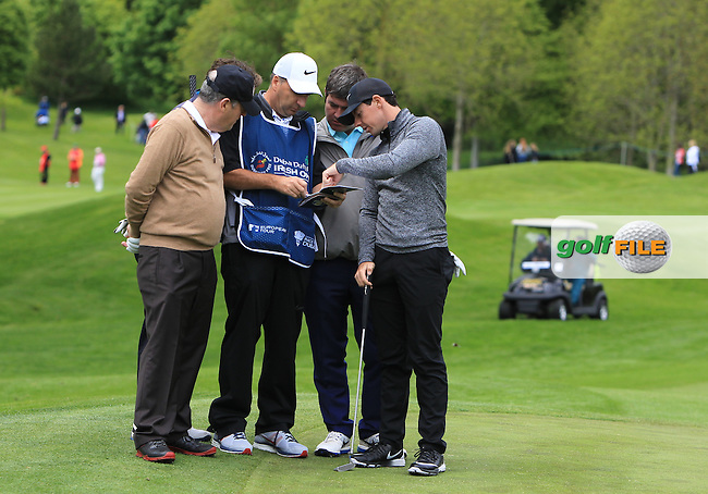 Jp McManus (AM), AP McCoy (AM), Kieran McManus (AM) and Rory McIlroy (NIR) on the 4th green checking the course map during Wednesday's Pro-Am round of the Dubai Duty Free Irish Open presented  by the Rory Foundation at The K Club, Straffan, Co. Kildare<br /> Picture: Golffile | Thos Caffrey<br /> <br /> All photo usage must carry mandatory copyright credit <br /> (&copy; Golffile | Thos Caffrey)