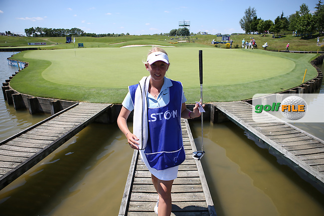 Jenny caddie Connor Arendell (USA) walking the planks on the 18th during Round One of the Alstom Open de France from Le Golf National, Guyancourt, Versailles, France. Picture:  David Lloyd / www.golffile.ie