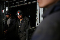 Coal miners exiting a lift after a 12-hour shift at one of the state-owned mines near Luoyang, Henan Province, China..14 Apr 2006