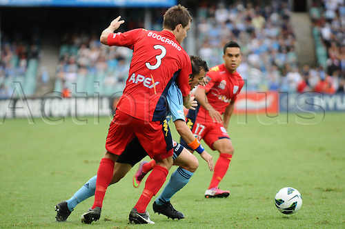 16.02.2013 Sydney, Australia. Sydneys Italian forward Alessandro Del Piero   is closely marked by Adelaide defender Nigel Boogaard during the Hyundai A League game between Sydney FC and Adelaide United from the Allianz Stadium.