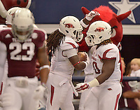 STAFF PHOTO BEN GOFF  @NWABenGoff -- 09/27/14 Arkansas fullback Patrick Arinze, right, congratulates running back Alex Collins after he ran for a touchdown during the second quarter of the game against Texas A&M in the Southwest Classic in AT&T Stadium in Arlington, Texas on Saturday September 27, 2014.