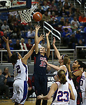 Liberty's Jazmin O'Bannon shoots through a crowd of Reno defenders during the Division I championship game in the NIAA basketball state tournament at Lawlor Events Center, in Reno, Nev., on Friday, Feb. 28, 2014. Reno won the state title 50-39. (Cathleen Allison/Las Vegas Review-Journal)