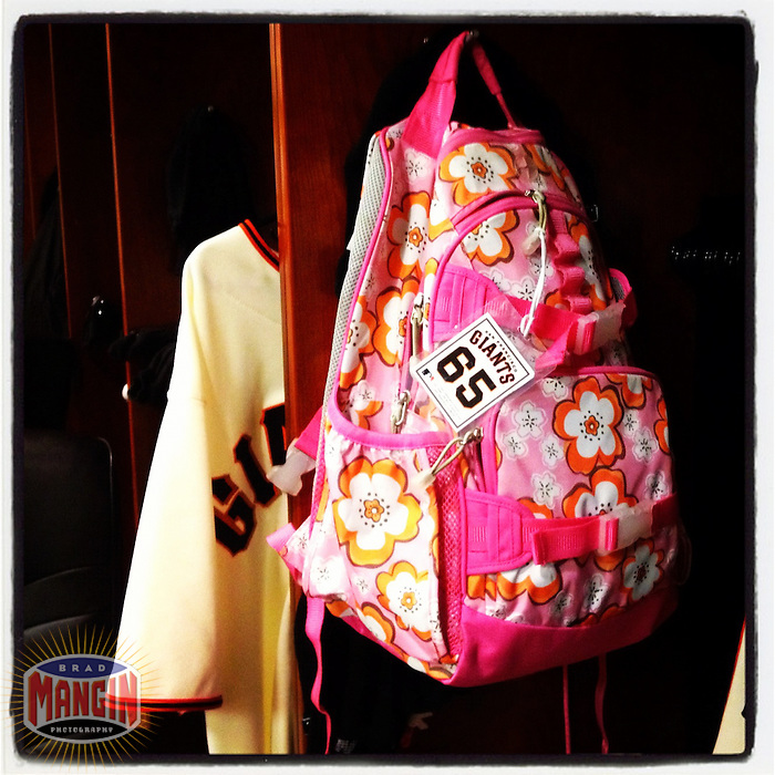 SAN FRANCISCO, CA - JUNE 4: Instagram of a pink back pack full of candy belonging to San Francisco Giants player Steve Edlefsen hangs in his locker in the Giants clubhouse before the game against the Chicago Cubs at AT&T Park on June 4, 2012 in San Francisco, California. (Photo by Brad Mangin)